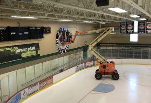 custom hockey rink signage installation
